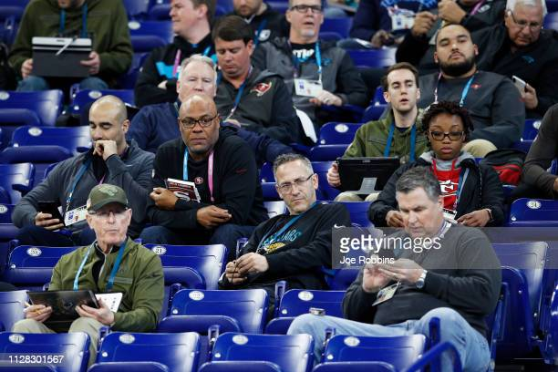 A group of coaches and scouts from various NFL teams observe the action during day two of the NFL Combine at Lucas Oil Stadium on March 1 2019 in...