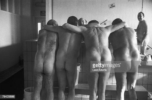 A group of coal miners in the bathhouse after a shift circa 1985