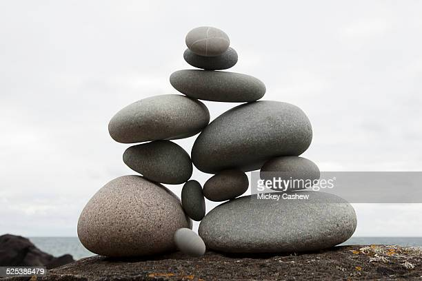 group of coastal stones balanced on top of each other - stone object stock pictures, royalty-free photos & images