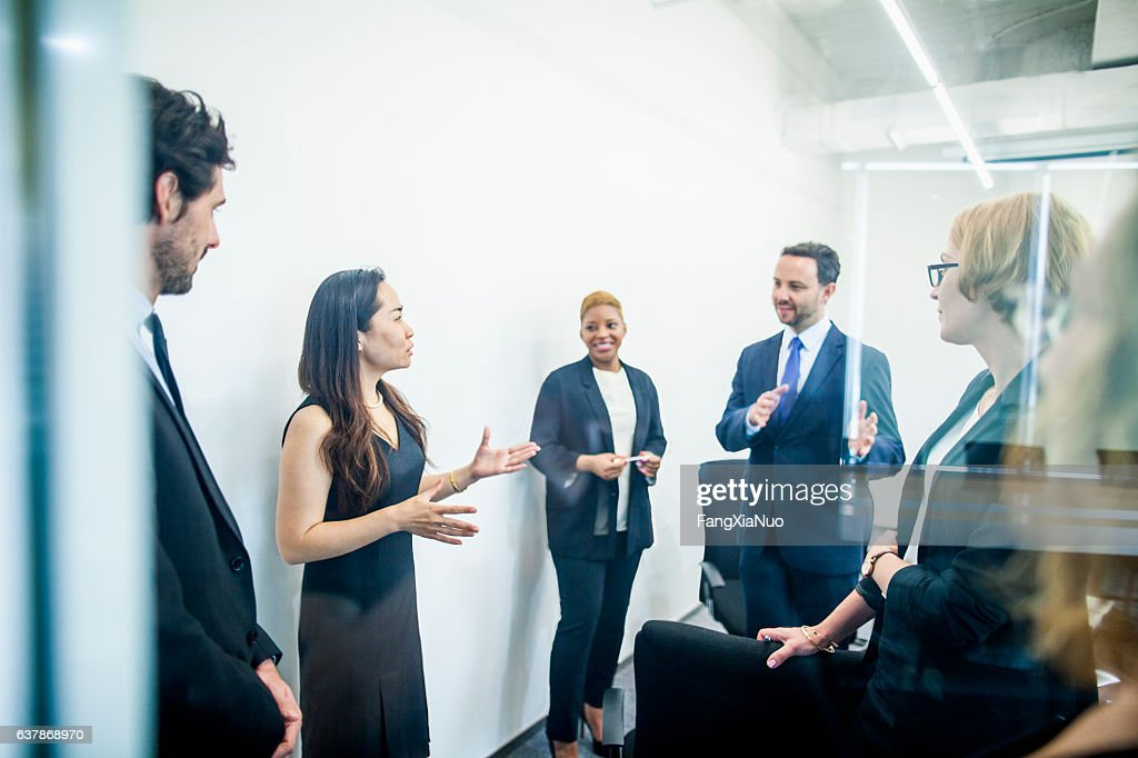 Group of colleagues having business meeting in office : Stock Photo