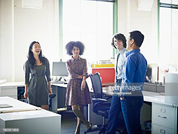 Group of colleagues in discussion in office