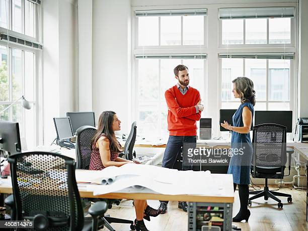 Group of colleagues in informal meeting in office