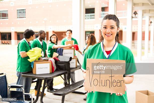 group of college student volunteers collect clothing donations. charity. - humanitarian aid stock pictures, royalty-free photos & images