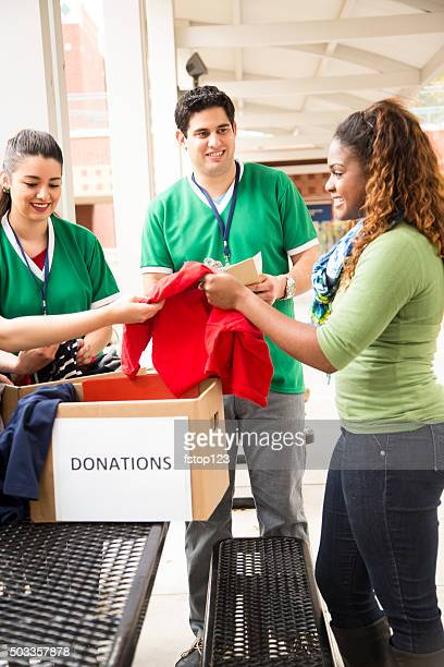 group of college student volunteers collect clothing donations. charity. - emergency management stock pictures, royalty-free photos & images