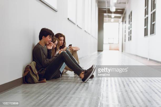 group of college students friends hanging around on campus before class - high school musical: the musical: the series stock pictures, royalty-free photos & images