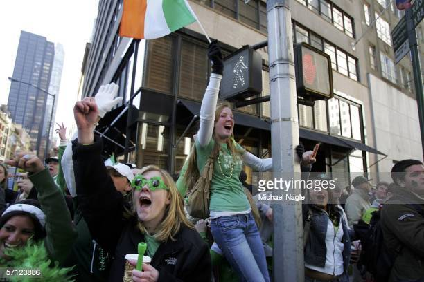 A group of college students from Sacred Heart in Fairfiled Connecticut celebrate as the St Patrick's Day Parade makes its way up 5th Avenue on March...