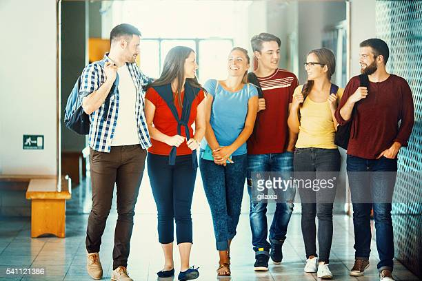 Group of college students in a hallway.