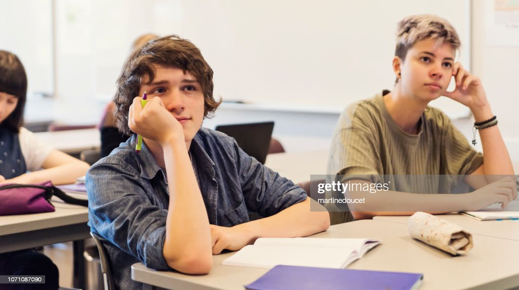 Group of College students listening in classroom. : Stock Photo