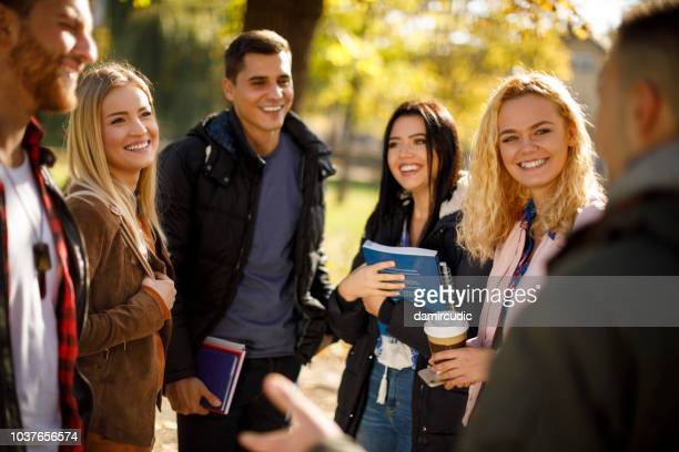 group of college students on university campus - tourism stock pictures, royalty-free photos & images