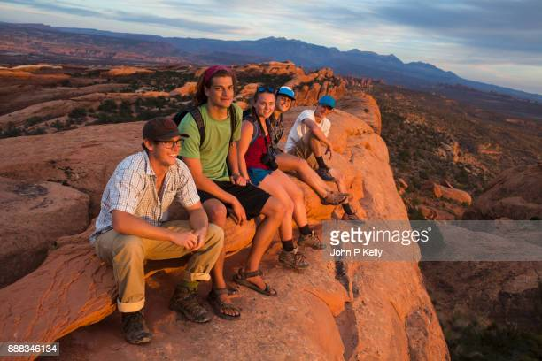Group of college students sitting relaxing in Arches National Park