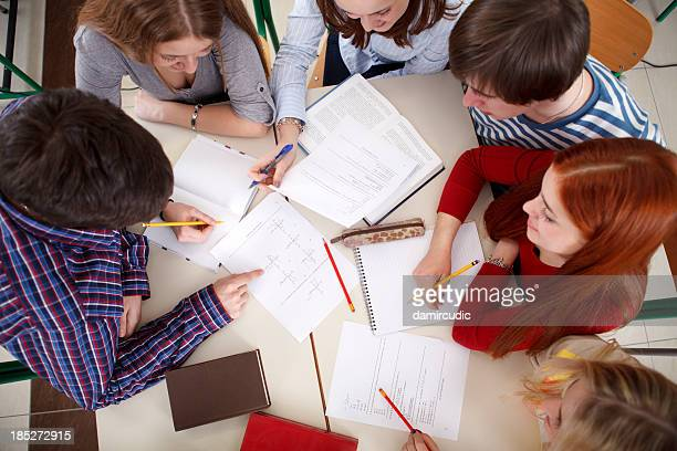 Group of college students studying together