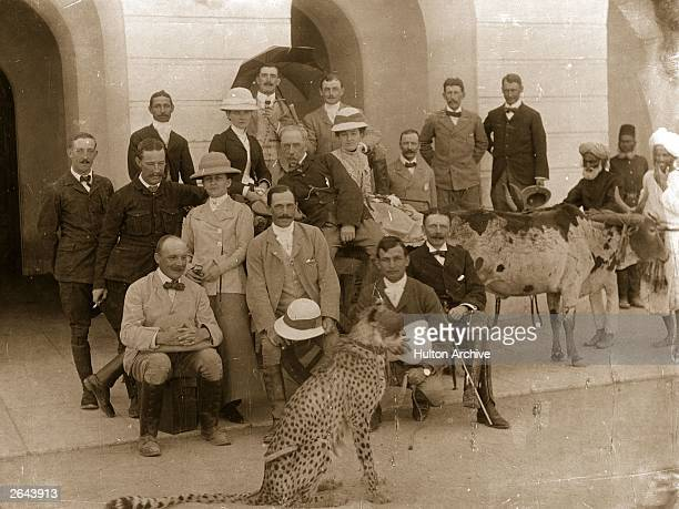 A group of colonials photographed with a pet cheetah at Secunderabad near Hyderabad during the days of the British Raj