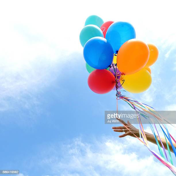 Group of colorful balloons in sky