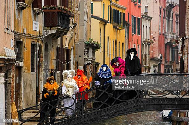 Group of colorful venetian masks on bridge in Venice