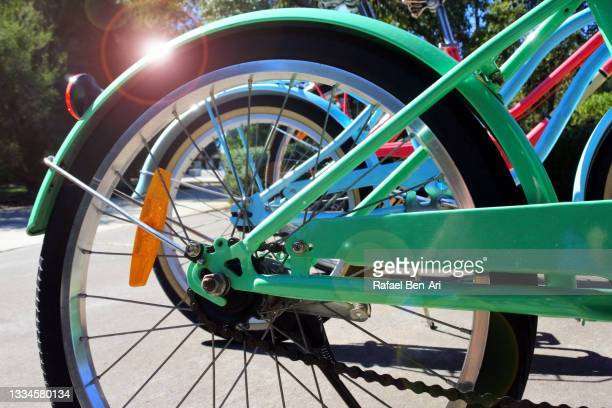 group of colourful bikes parking in a public park - rafael ben ari fotografías e imágenes de stock