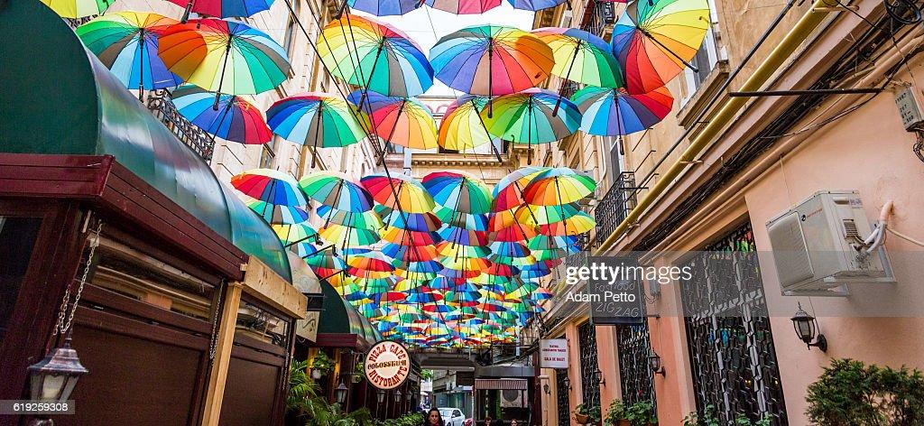Group of Colourful Umbrellas in Narrow Street, Bucharest, Romania : Stock Photo