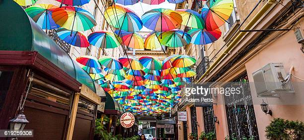 Group of Colourful Umbrellas in Narrow Street, Bucharest, Romania