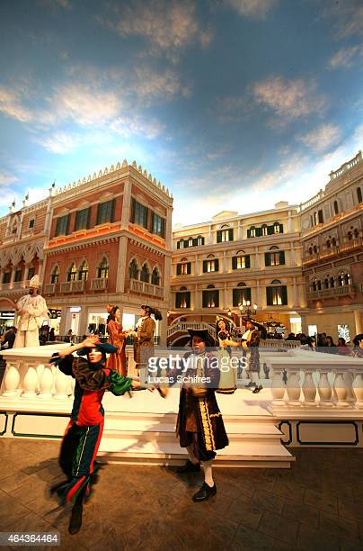 A group of Comedia Del' Arte actors entertain visitors at the Venetian casino's shopping mall on February 24 2008 in Macau China The Venetian...