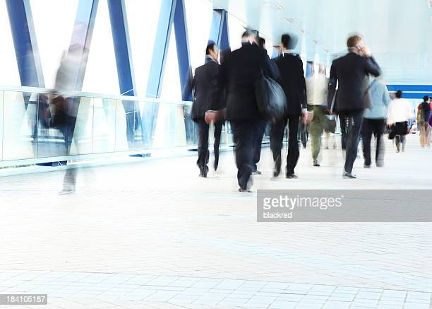 Group of Commuters in Business Suit Walking Motion Blur