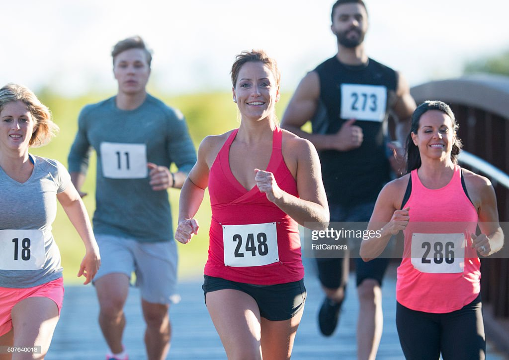 A group of competetive runners racing. : Stock Photo