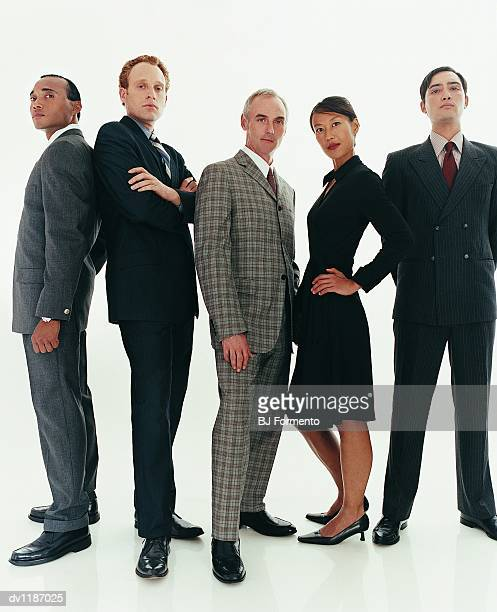 Group of Confident Businessmen and a Businesswoman Standing in a Line