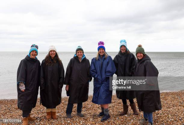 group of confident women smiling after a day of open water swimming - female friendship stock pictures, royalty-free photos & images
