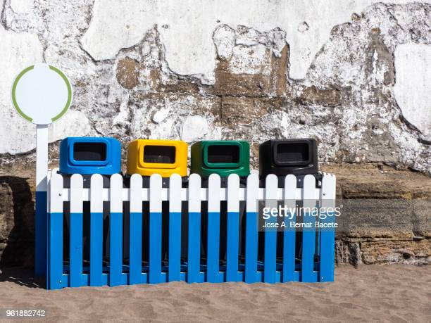 group of containers for the  recycling glass, carton and plastic, close to the beach. city angra do heroísmo, terceira island in the azores islands, portugal. - disposable stock photos and pictures