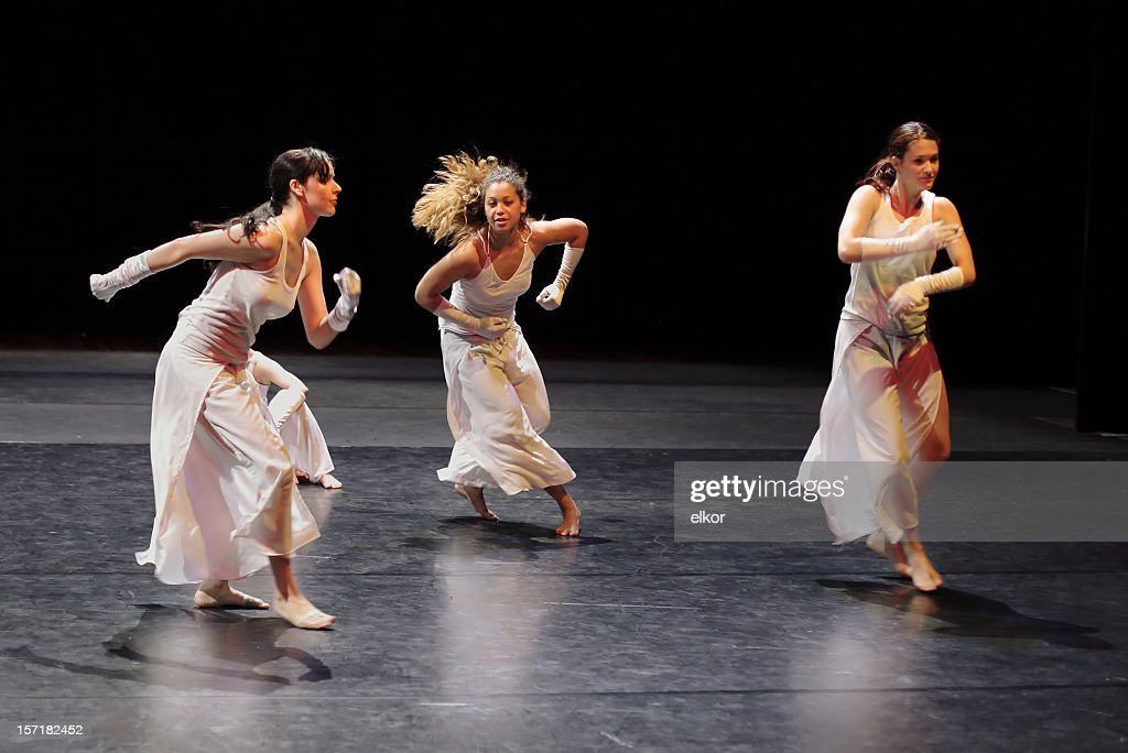 Group of contemporary dancers performing on stage. : Stock Photo