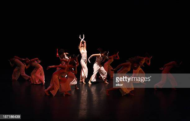 group of contemporary dancers performing on stage - performance stock pictures, royalty-free photos & images