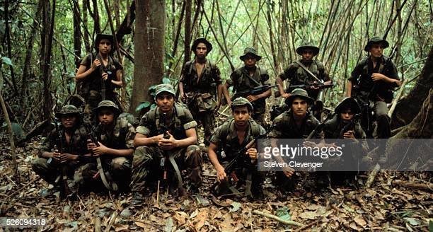 A group of contra Special Forces pose for a photograph while on a patrol inside a remote area of northern Nicaragua | Location Northern Nicaragua...