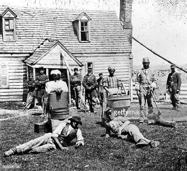 Group of contraband slaves at Allens farm house near Williamsburg Road in the vicinity of Yorkville Virginia during the American Civil War from the...