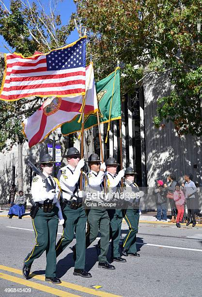 Group of cops in uniform with flags during the parade of Martin Luther King in Orlando, Florida, January 18, 2014