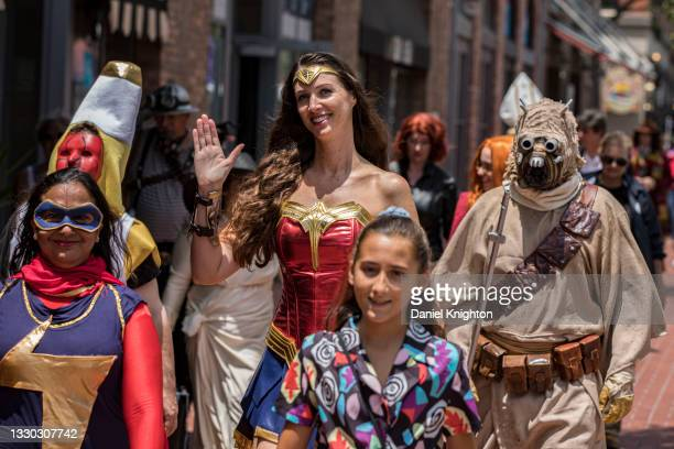 Group of cosplayers march along 5th Avenue during the Opening Ceremonies for the San Diego Causeplayer Community Shrine at San Diego Convention...