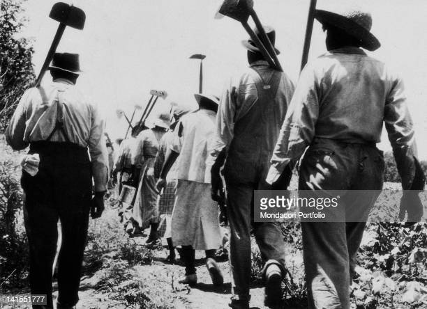 A group of black slaves going to work on a plantation USA
