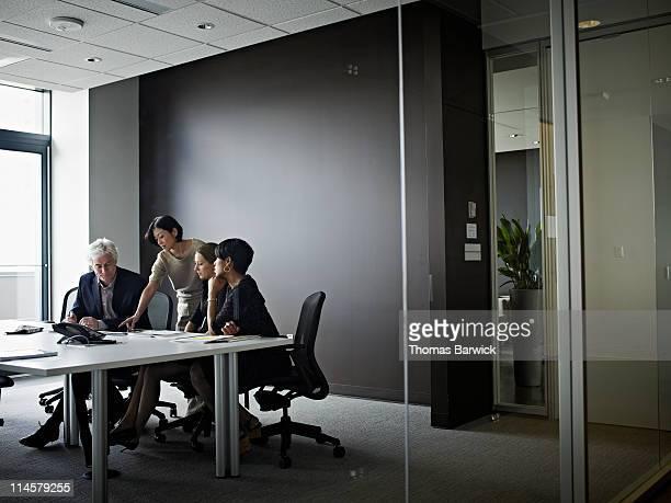 group of coworkers in discussion in office - person gemischter abstammung stock-fotos und bilder