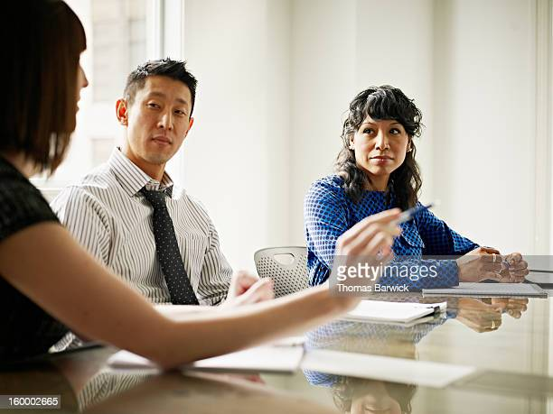 group of coworkers in discussion in office - leanintogether stock pictures, royalty-free photos & images