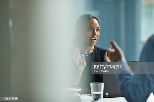 group of co-workers standing around desk and having meeting - selective focus stock pictures, royalty-free photos & images