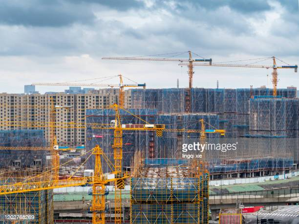 group of cranes on construction site - south east asia stock pictures, royalty-free photos & images