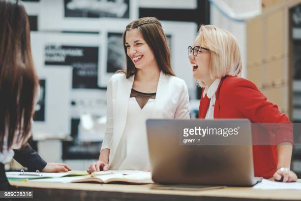 group of creative professionals in meeting - bright stock photos and pictures