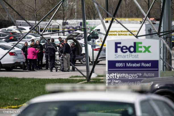 Group of crime scene investigators gather to speak in the parking lot of a FedEx SmartPost on April 16, 2021 in Indianapolis, Indiana. The area is...