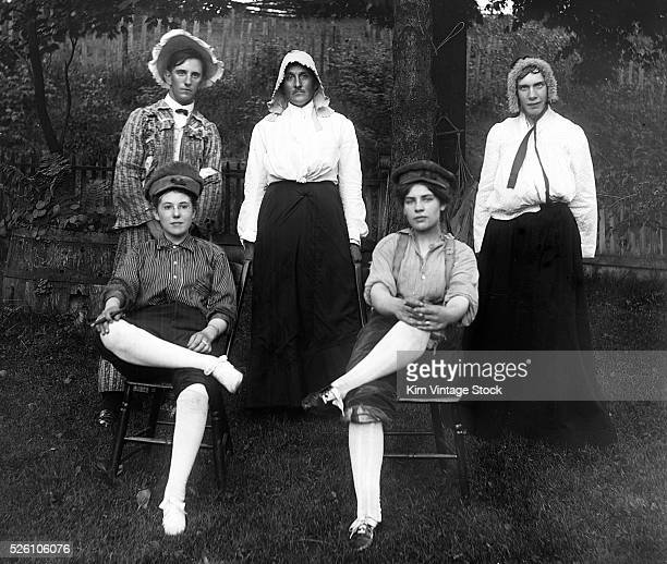 A group of cross dressing adults pose for a portrait ca 1910
