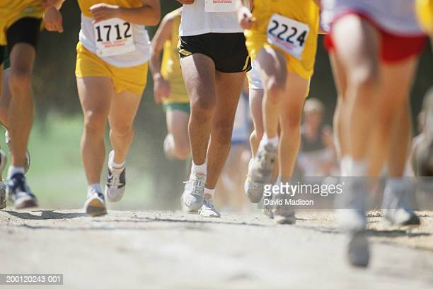 group of cross-country runners, low section (digital enhancement) - cross country running stock pictures, royalty-free photos & images
