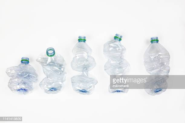 group of crumpled plastic drink water bottles for recycling - plastic stock pictures, royalty-free photos & images