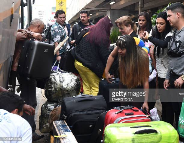 A group of Cuban doctors arrive at Brasilia's airport Brazil to fly back to Cuba on November 22 2018 The Cuban government decided to withdraw from...