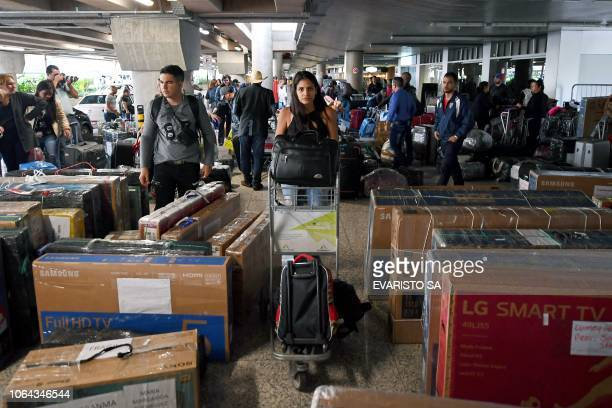 A group of Cuban doctors head for the checkin at Brasilia's airport Brazil to fly back to Cuba on November 22 2018 The Cuban government decided to...