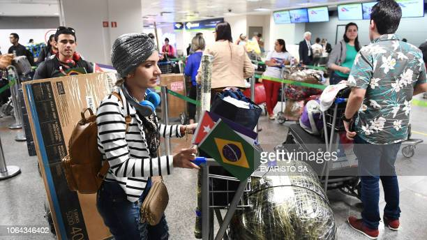 A group of Cuban doctors wait in a line to checkin at Brasilia's airport Brazil to fly back to Cuba on November 22 2018 The Cuban government decided...