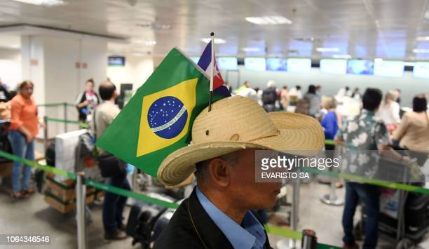 A group of Cuban doctors wait to check in at Brasilia's airport Brazil to fly back to Cuba on November 22 2018 The Cuban government decided to...