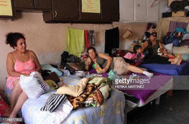 A group of Cuban migrants wait for their turn to cross to the United States to apply for political asylum at the El Buen Pastor migrant shelter in...