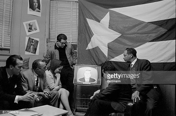 Group of Cuban refugees in Manhattan watch President Kennedy delivering a speech on television. Kennedy described a seven-point program directed at...