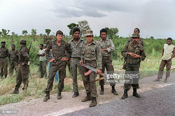 A group of Cuban soldiers helping Angolan regular army and Sovietbacked Marxist MPLA regime in Luanda patrol 29 February 1988 near Cuito Cuanavale...